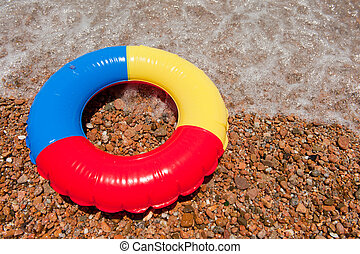 Colorful plastic floating toy at the beach