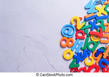 colorful plastic letters on white background, Top view