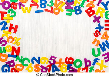Colorful plastic numbers and letters as frame