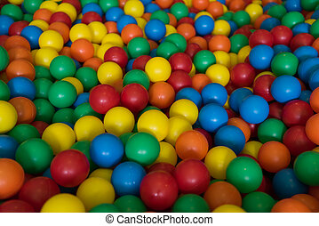 Colorful plastic toy balls in the play pool