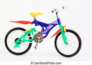 colorful plastic toy two-wheeled bicycle on white background