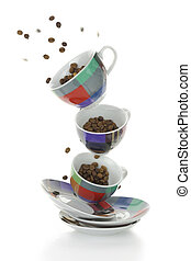 Colorful plates and cups with coffee beans isolated on white
