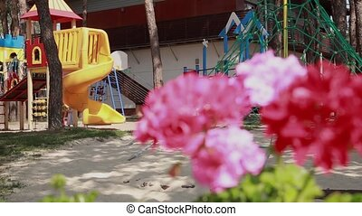 Colorful playground and beautiful flowers