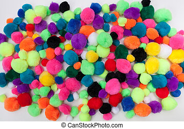 Colorful Pom Poms on a white background