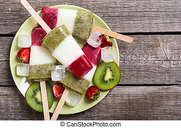 Colorful popsicle with strawberry , yogurt and kiwi
