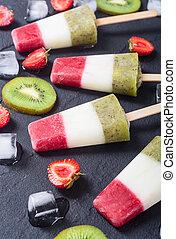 Colorful popsicle with strawberry , yogurt and kiwi