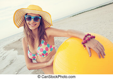 Colorful portrait of cheerful girl on the beach