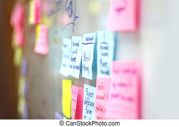 colorful post it on the glass wall