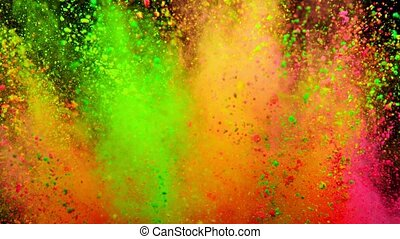 Colorful powder exploding on black background in super slow motion.