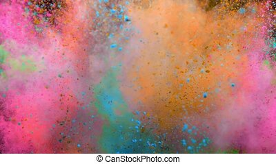 Colorful powder exploding on black background in super slow...