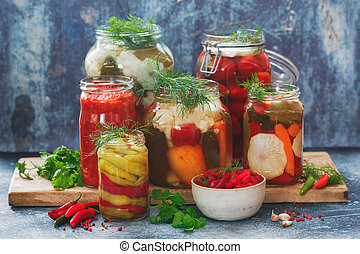 Colorful preserved and marinated seasonal vegetables with herbs