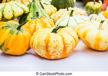 Autumn decoration, pumpkins in basket isolated on white