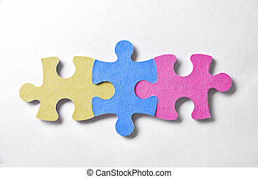 Colorful puzzle pieces aligned and bonded