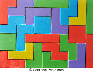 Abstract Colorful puzzle pieces put together. this makes a good background. This toy is made out of cardboard and this image is a photograph.