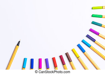 Colorful rainbow marker pen on white copy space with one open