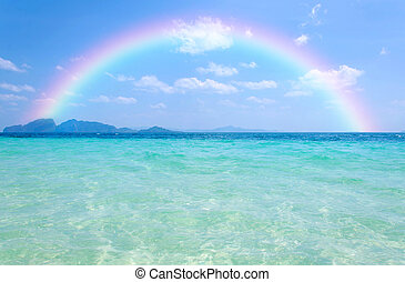 Colorful rainbow over a Tropical beach of Andaman Sea,...
