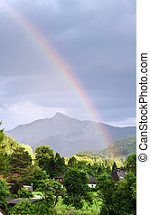 Colorful rainbow over the mountains