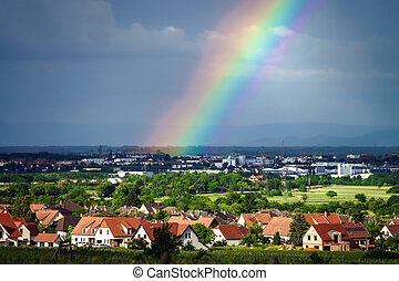 Colorful rainbow over the village, countryside, France
