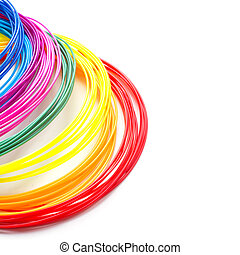 Colorful rainbow plastic filaments with for 3D pen laying on white background. New toy for child.