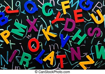 Colorful random letters on a blackboard - Random colorful...