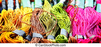 Colorful raw silk thread background.