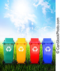 Colorful recycle bins in nature