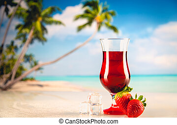 Colorful red cold drink on a beach, summer background