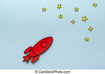 Colorful red rocket zooming through space in a concept of ambition and success