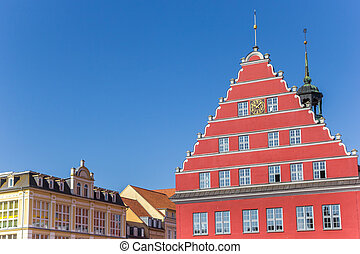 Colorful red town hall at the market square of Greifswald