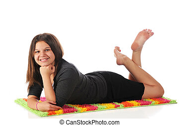 Colorful Relaxation - An attractive young teen relaxing on...