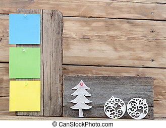 colorful reminder notes attached on a old wooden signboard with christmas decorations