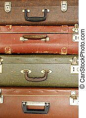 Colorful retro suitcase on a beige background