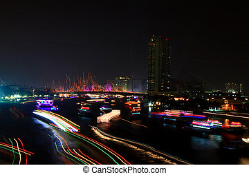 Colorful river with light trail from ship over Chao Phraya River on Father's Day in Thailand