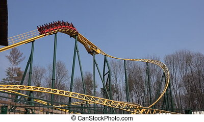 Colorful Rollercoaster Against Blue Sky