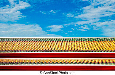 Colorful roof tiles of temple on blue sky background