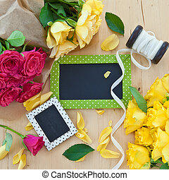 Colorful roses and a little blackboard
