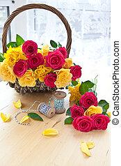 Colorful roses in a vintage basket