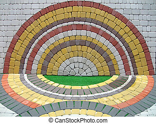 colorful round construction brick wall, symmetry details