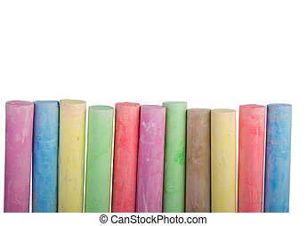 Colorful row of chalk sticks with copy space isolated on a ...