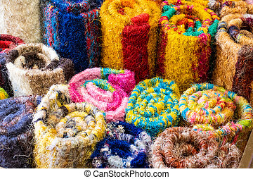 Colorful rugs made of fibres of cabuya or fique.