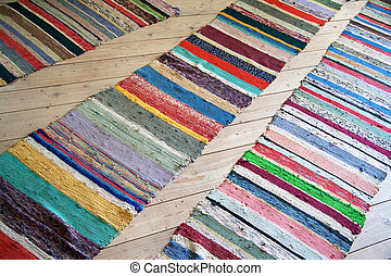 colorful rugs on the wooden floor