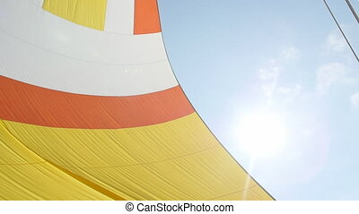 Colorful sail on blue sky background on the island of Crete....