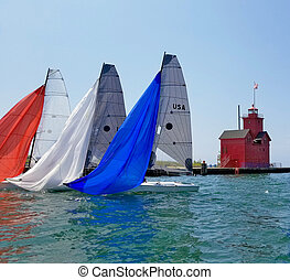 colorful sailboat spinnakers in Michigan harbor - red white...