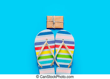 colorful sandals and beautiful gift on the wonderful blue background