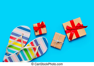 colorful sandals and beautiful gifts on the wonderful blue background