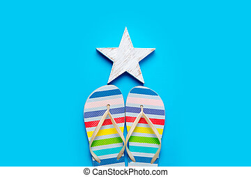 colorful sandals and beautiful star shaped toy on the wonderful blue background