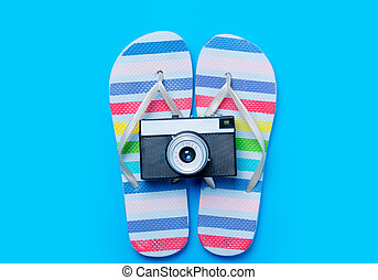 colorful sandals and retro camera on the wonderful blue background
