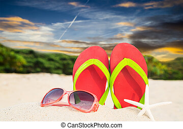Colorful sandals on beach