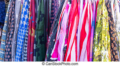 Colorful scarves background. Clothing hanging on a street...
