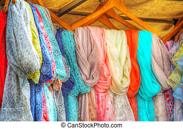 scarves in an external stall - colorful scarves in an...
